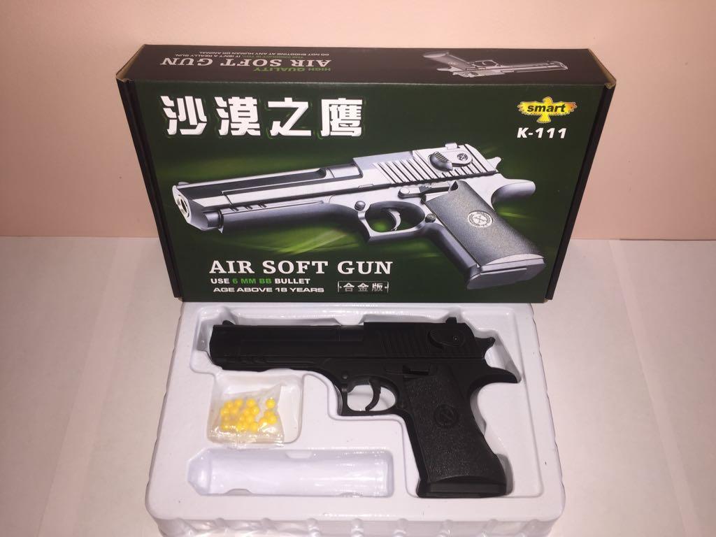 Детский металлический пистолет,с пружинным механизмом,стреляет пласт.шариками.(К.111) Размер упак.25см*15см*4,5см.