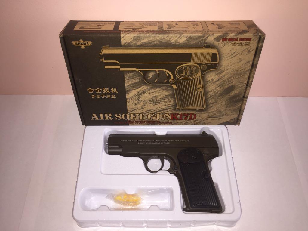 Детский металлический пистолет,с пружинным механизмом,стреляет пласт.шариками.(К,17D) Размер упак.23см*14см*4,5см.