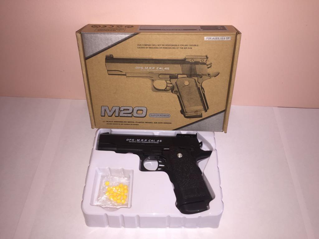 Детский металлический пистоле,с пружинным механизмом,стреляет пласт.шариками.(М.20) Размер упак.20см*14,5см*4,5см.