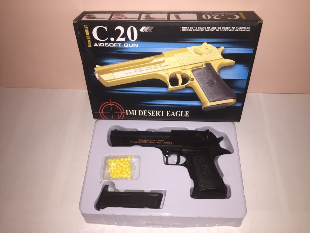 Детский металлический пистолет,с пружинным механизмом,стреляет пласт.шариками.(С.20) Размер упак.27см*17,5см*5см.