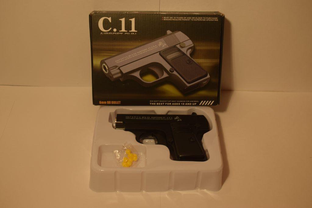 Игрушечный пистолет.(металл+пластик)(С.11) Размер упак.17*12см.