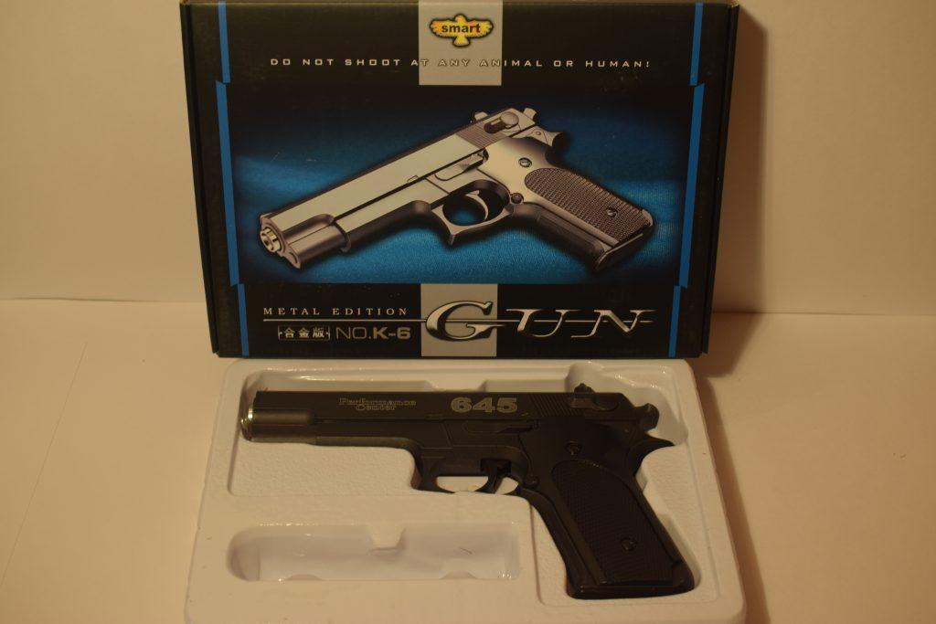 Игрушечный пистолет.(металл+пластик) (К.6) Размер упак.24*17см.