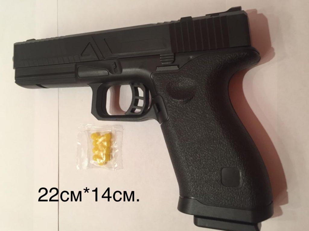 (Р) Пластмассовый пистолет,стреляет пласт.пульками,в пакете.Арт.2697.