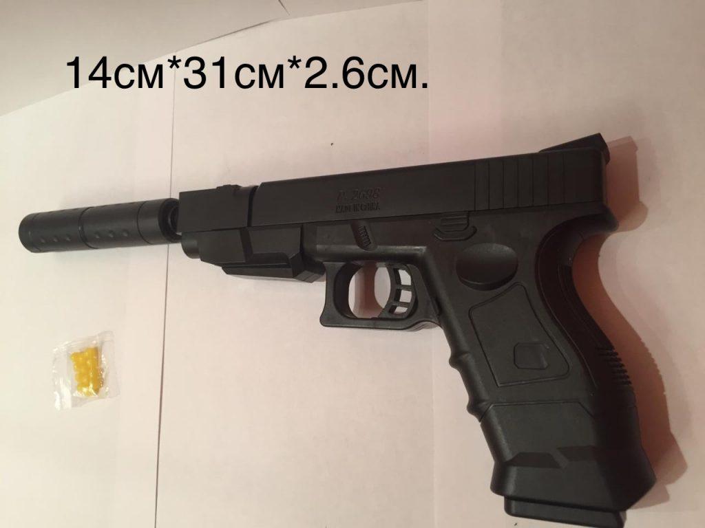 (Р) Пластмассовый пистолет,стреляет пласт. пульками+глушитель.В пакете.Арт.2698.