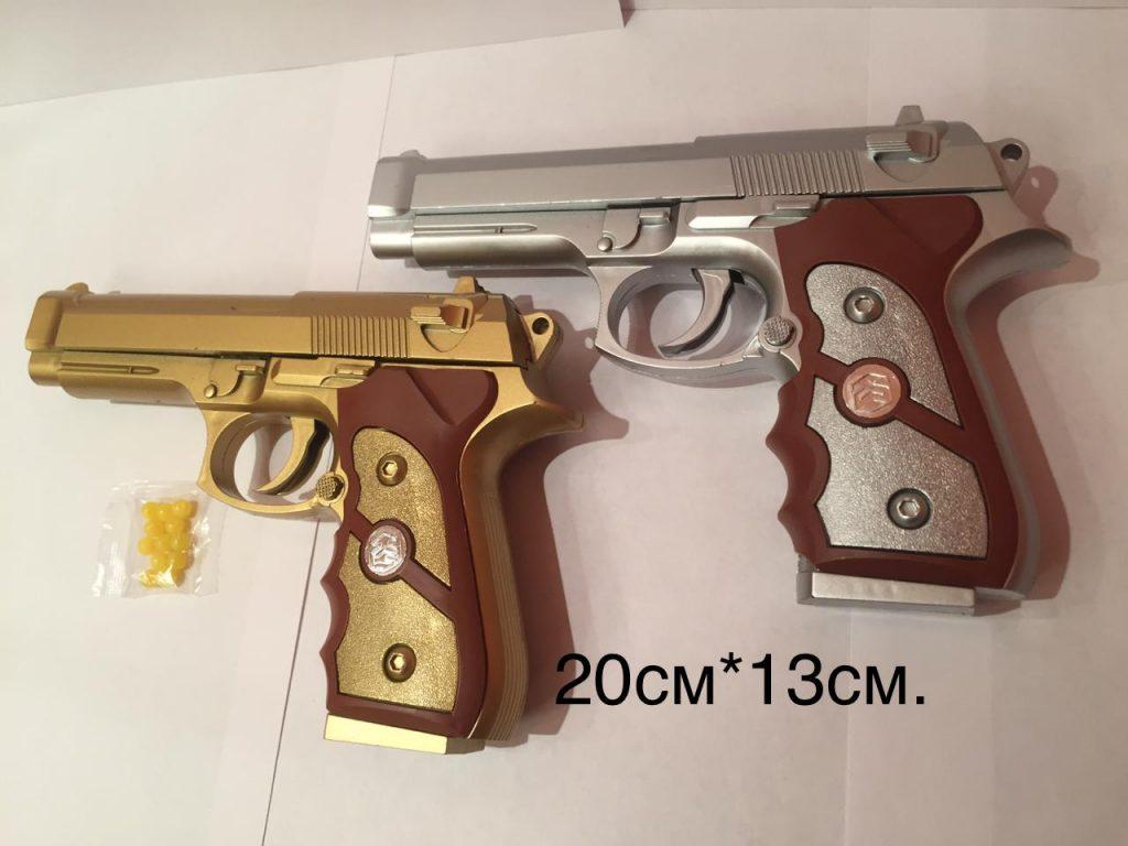 (Р) Пластмассовый пистолет,стреляет пласт.пульками.два цвета.в пакете.Арт.779.
